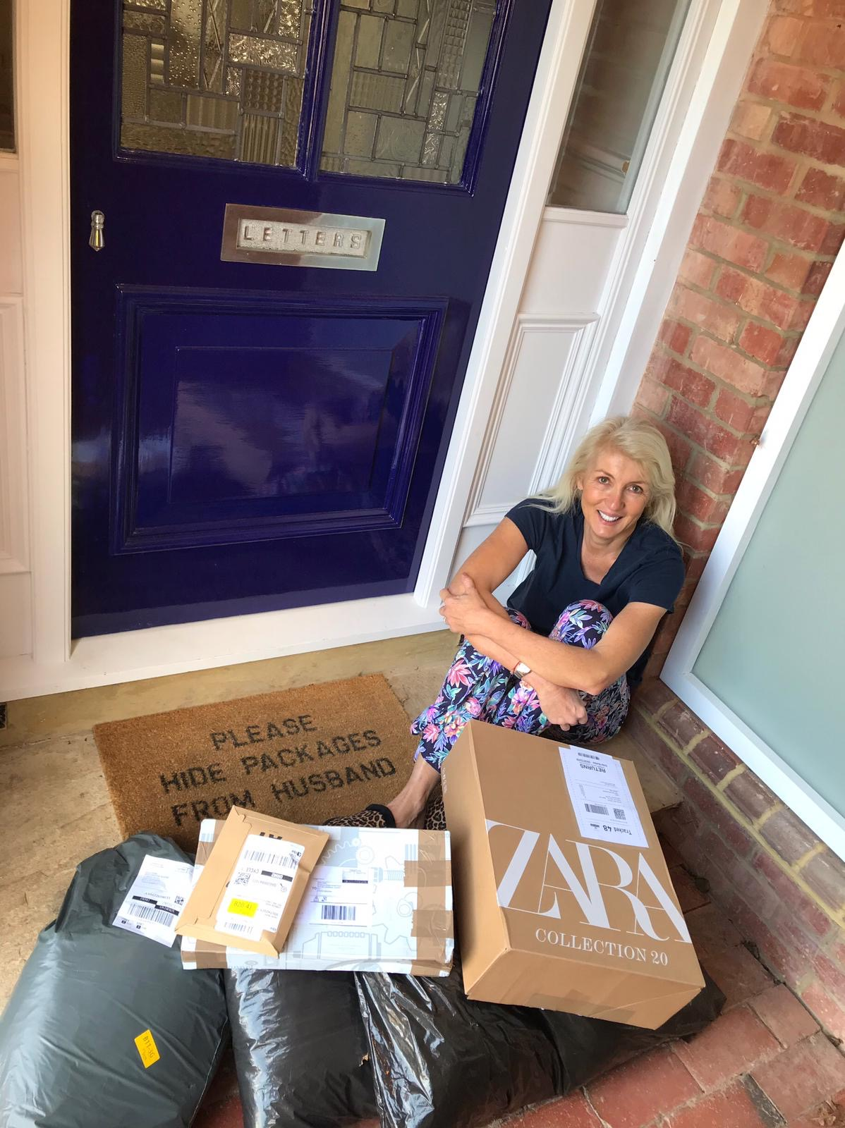 Jayne is sat on her front doorstep surrounded by lots of parcels – she has done a lot of online shopping!